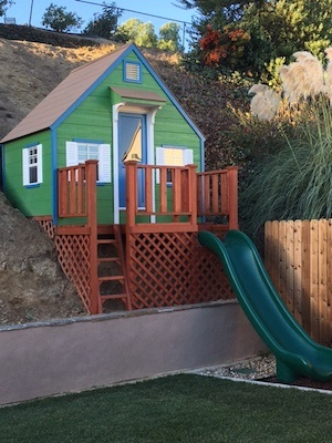 We built this playhouse into a back yard hillside.